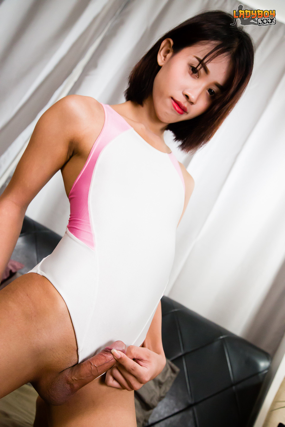 ladyboy little Nene does a swimsuit scene on Ladyboy XXX!!! Nene is a tiny and petite  Asian tgirl! She has a cute face, a tight slim body, and big hard cock that  can't be ...